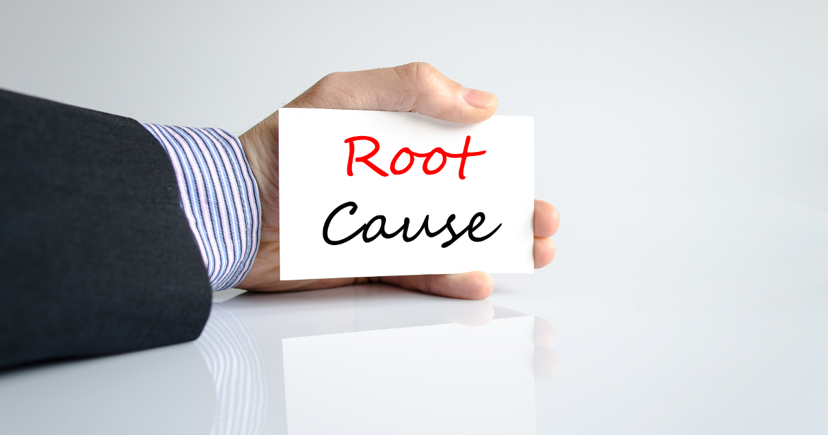 hand holding card that says root cause